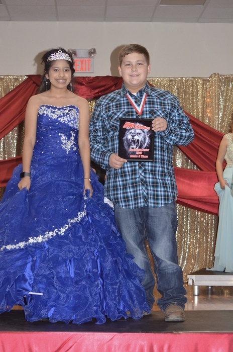 The winner of the High School division is Carolina Cruz and Jaxon Gonzalez.