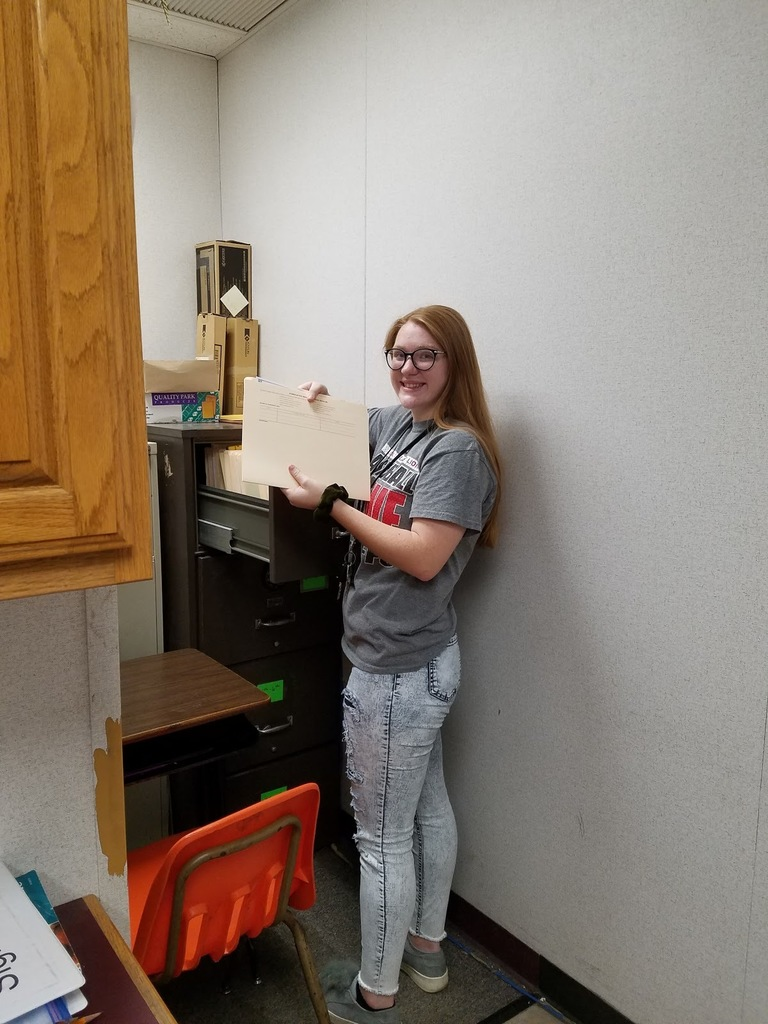 Jade McCoy working in the elementary office.